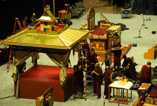 Tibetan Buddhist monks assembling the golden Kalachakra pavilion for the intiation, ladder, planning table with instructions, HH the Great 14th Dalai Lama's throne, on stage, Kalachakra For World Peace, Verizon Center, Washington D.C., USA by Wonderlane