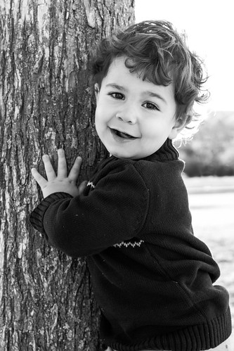 Luke by the tree bw facing left