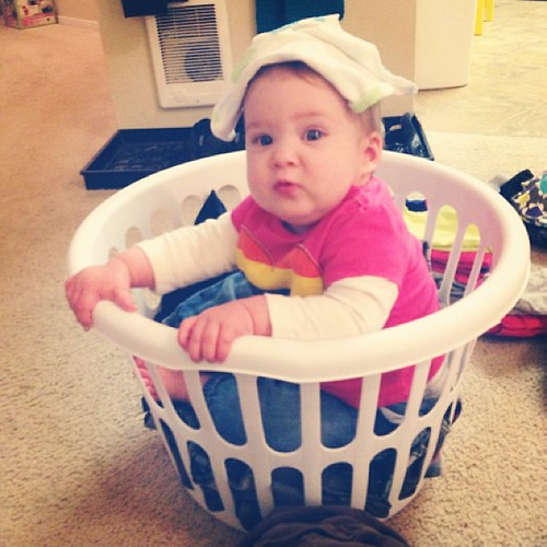 Such a good laundry folder. She attributes her skills to the washcloth-as-a-hat.