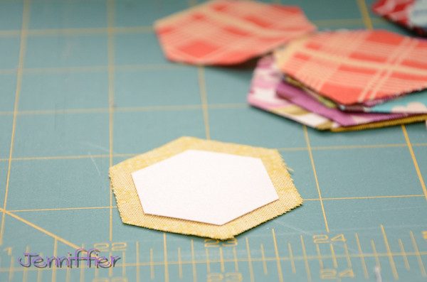 making tiny hexagons out of scraps from go cutter