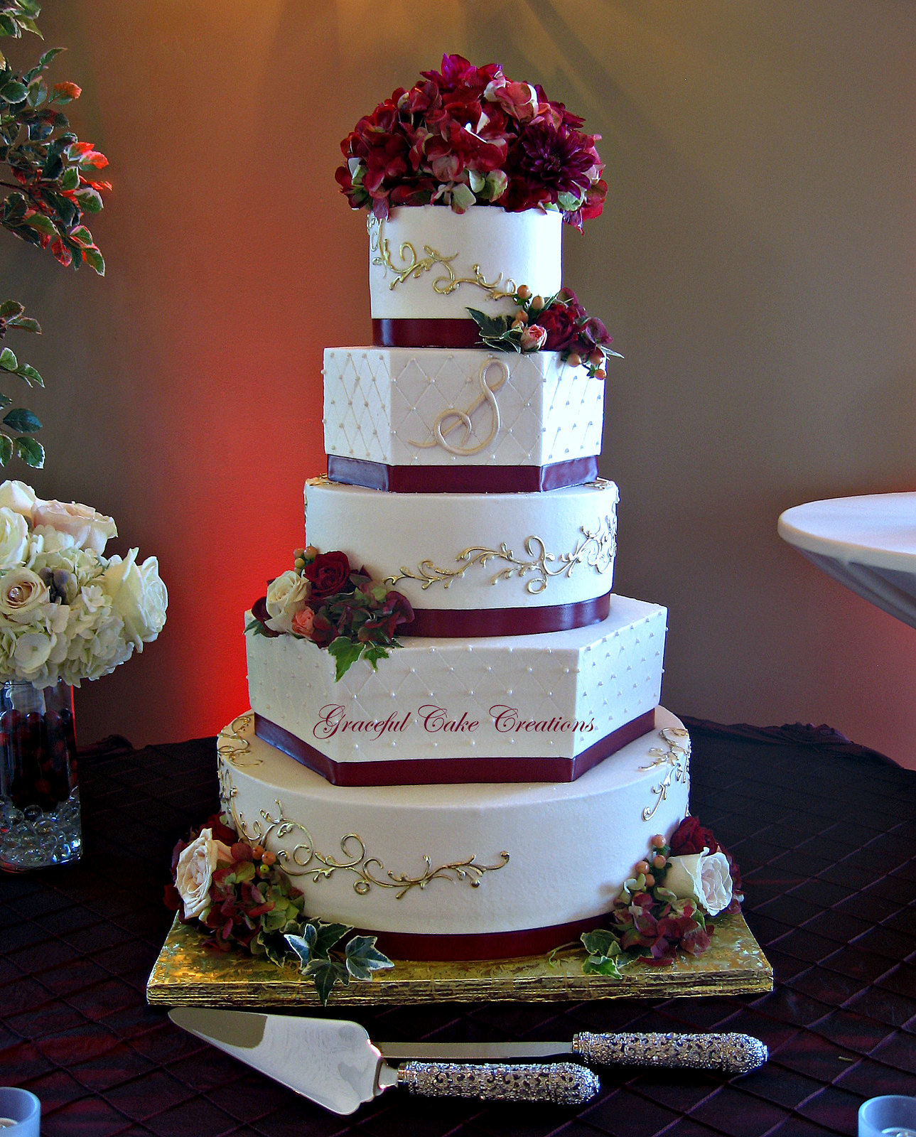 Elegant Ivory Buttercream Wedding Cake with Burgundy Ribbo