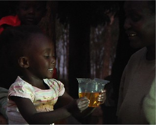 Girl drinking from Kit Yamoyo