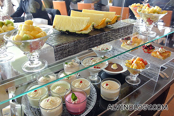Wide selection of food items and fruits for dessert