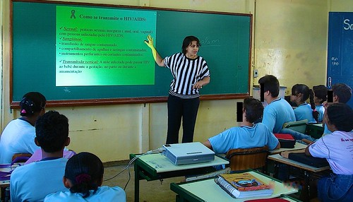 AAVE's President, Flávia, providing education in local schools on HIV/AIDS and its prevention