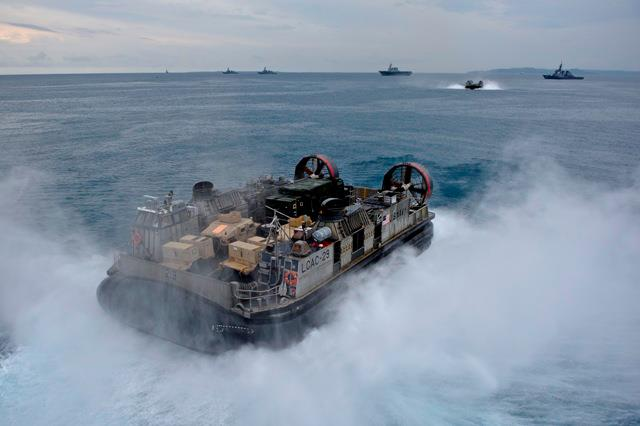 Landing Craft Air Cushion 29, assigned to Naval Beach Unit 7, exits the well deck