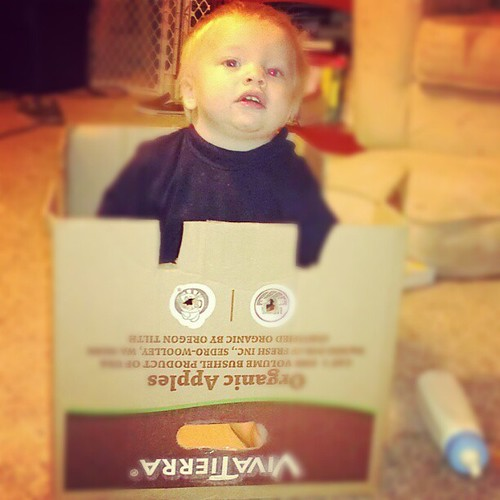 Ari playing in the box train that Judah made