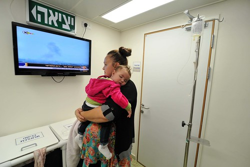 A woman with her baby at the Barzlai Hospital in Ashkelon receives dialysis treatment during rocket attacks.