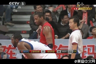 December 2nd, 2012 - Tracy McGrady points to Yao Ming in the stands