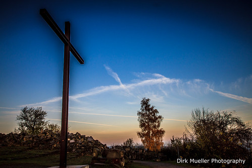 the cross with a sunrise by Dirk Mueller Photography