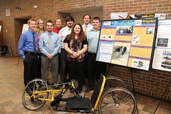 Hand-Crank Cycle 2 Team with poster and hand-crank cycle