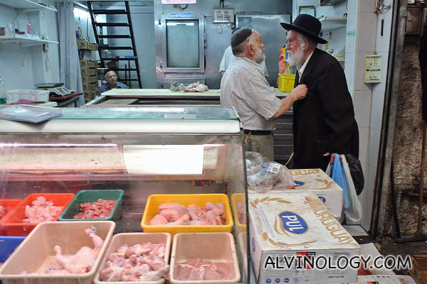 An elderly ultra-orthodox man chatting with his friend