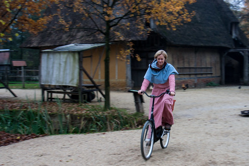 medieval woman on a bike