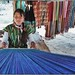 WeGoTwo posted a photo:	This young long neck tribe girl was happy to pose for some shots while she did some weaving.