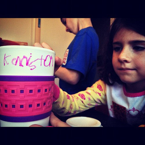 Decorating her new hot cocoa mug.