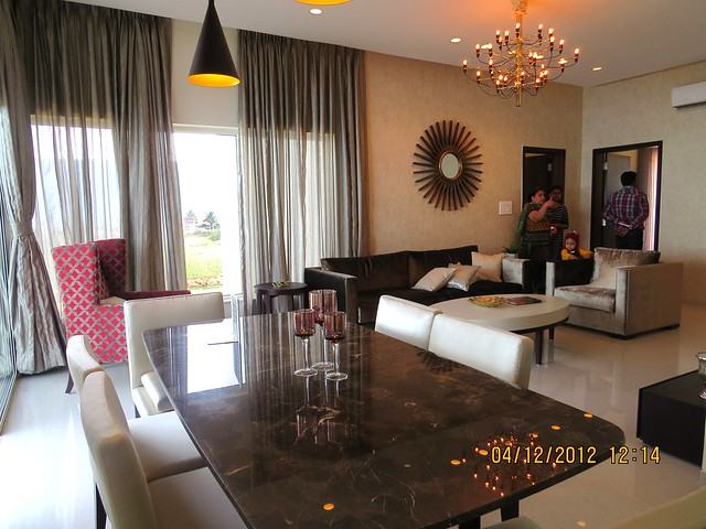 Glass wall & living from Dining - Show flat of Siddhashila Eira, 2 BHK & 3 BHK Flats in 16 Story 2 Towers with Amenities & Parking on & under the Podium at Koyate Vasti, Punawale, PCMC, Pune 411033