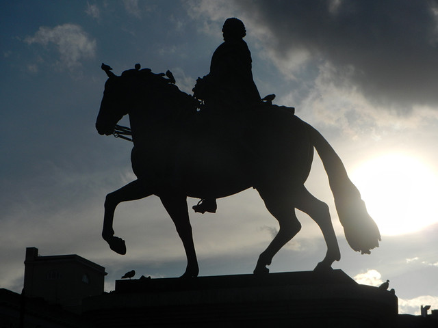 The sun flare creates a silhouette of this statue of a horse in Madrid, Spain