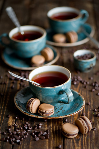 Tea with chocolate macarons