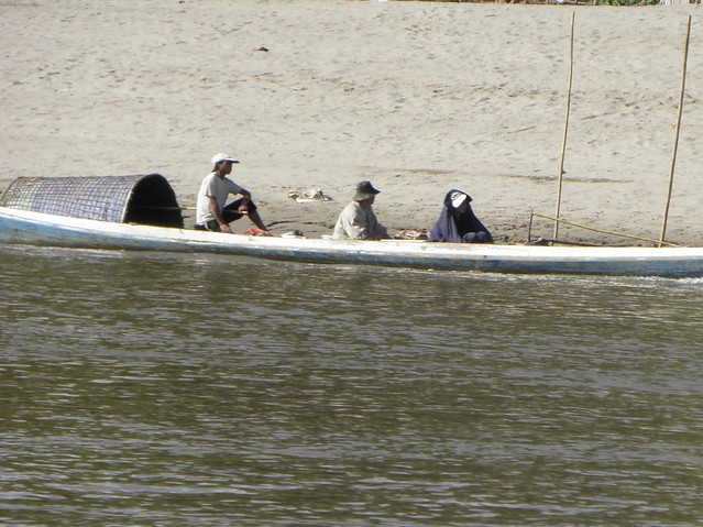 Fishermen in a boat on the Mekong