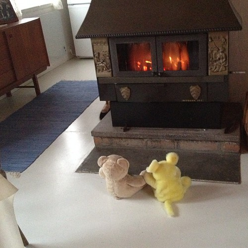 Bigga the Bear and Mathilda Mouse are enjoying the warmth of the fire place