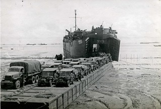 Tarakan, LST 993 unloading on a pontoon causeway, 1945