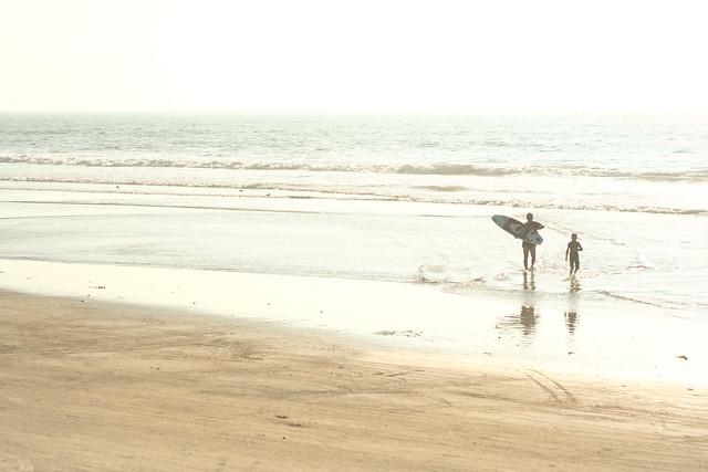 surfers in oceanside