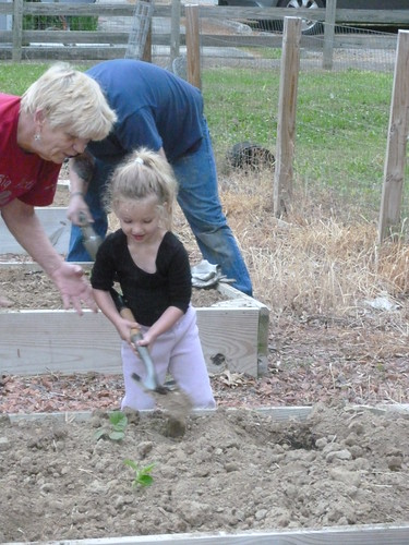 Congregation members of all ages help tend to the church garden at First Baptist Church in Sanford, North Carolina.