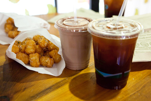 Tater tots with shaved Parmesan cheese, Chocolate milkshake and Cardamom Honey iced tea
