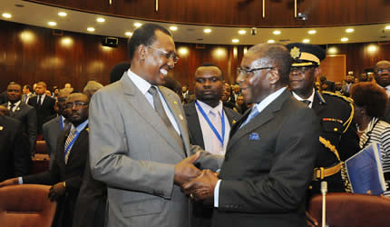 Presidents Idriss Deby of Chad and Robert Mugabe of Zimbabwe at the ACP Summit in Equatorial Guinea on December 13, 2012. Mugabe addressed the summit on south-south cooperation. by Pan-African News Wire File Photos