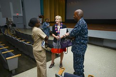 Ms. Lynn Simpson engages with Sailors after giving a keynote speech for the Hawaii Joint Forces Diversity Committee's observance of Women's Equality Day. (U.S. Navy/MC2 Brian M. Wilbur)