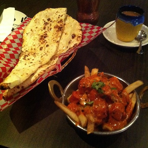 Butter chicken fries and naan. #yegfood by raise my voice