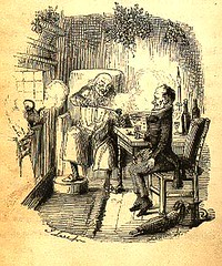 Charles Dicken: A Christmas Carol, wood engraving on p.164: Scrooge discusses affairs with Bob Cratchit over a bowl of smoking bishop