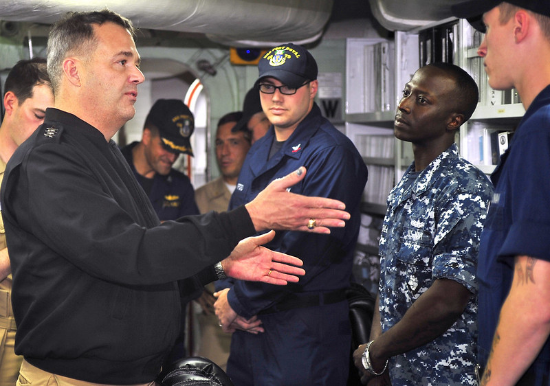 Vice Adm. Tom Copeman meets Sailors aboard the Hawaii-based guided-missile cruiser USS Port Royal