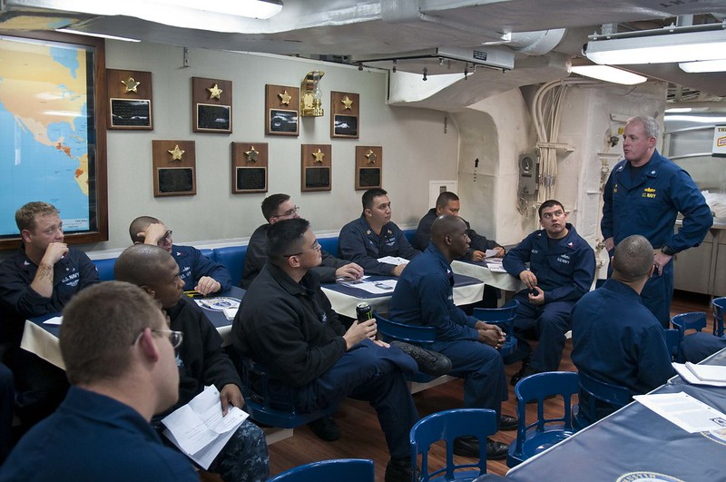 Commanding Officer, Cmdr. Joseph Ring, speaks to 1st class petty officers during 356 CPO training.