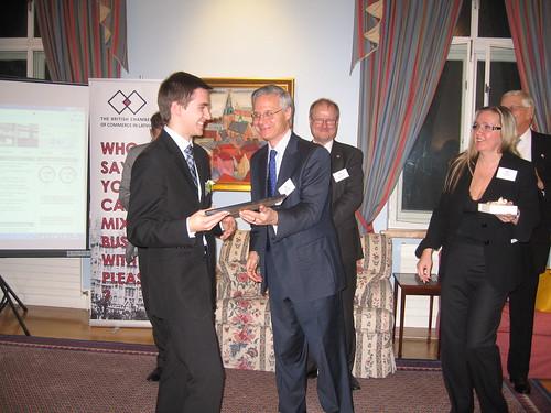 New graduate member Sigvards Krongorns with H.M. Ambassador Andrew Soper