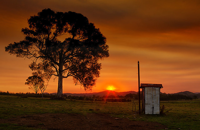 Sunset over the outhouse email