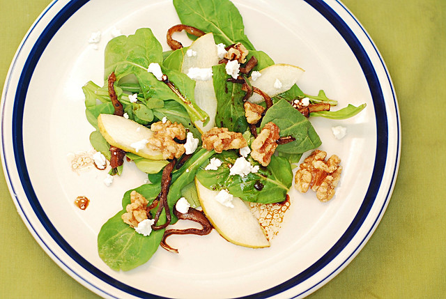 Arugula salad with caramelized onions, walnuts, pears, and Gorgonzola cheese