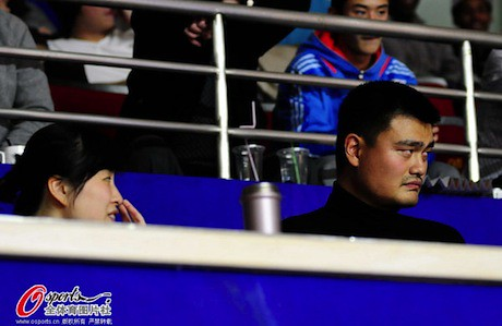 December 2nd, 2012 - Yao Ming and wife Ye Li watch the Shanghai Sharks play Tracy McGrady's Qingdao team