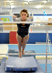 balance beam(0.0), floor gymnastics(0.0), swimmer(0.0), sports(1.0), gymnastics(1.0), gymnast(1.0), artistic gymnastics(1.0), uneven bars(1.0), athlete(1.0),