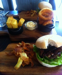 picture of great burgers served on wooden boards