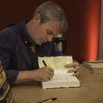 Mark Haddon Book Signing | The author of The Curious Incident of the Dog in the Night-Time signs copies of his new book of short stories © Robin Mair
