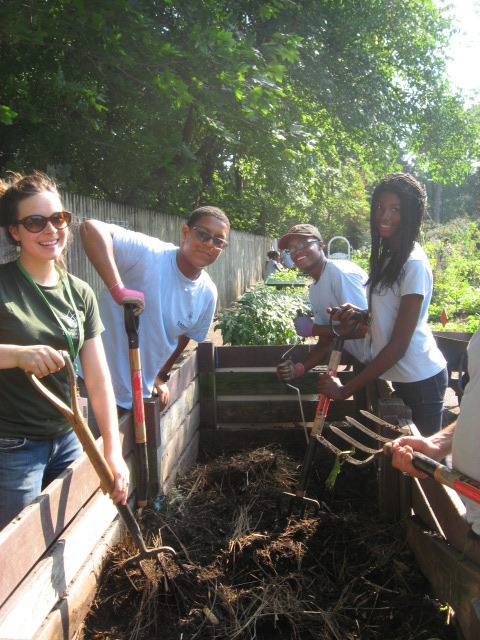 Turning the compost in the Children's Garden. Photo by GAP.