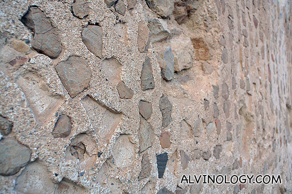 The motif was created with small stones stuck into the wall