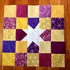 Purple/gold star block for Quilts for Kids