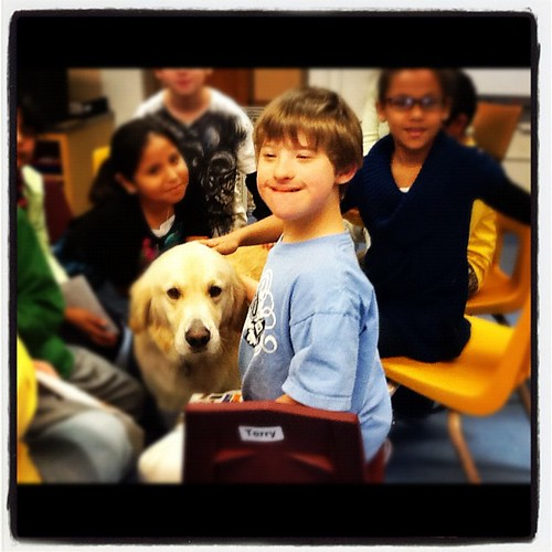 Leo loves Friday visits from Finn the therapy dog (the children read to him).