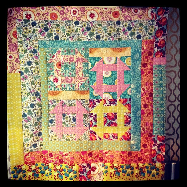 "2.5 hours of mindless sewing = 1 quilt top measuring approx 44x50""."
