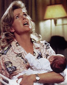 A pajamad Murphy Brown holds her baby and appears to be letting out a cry of anguish to the heavens.