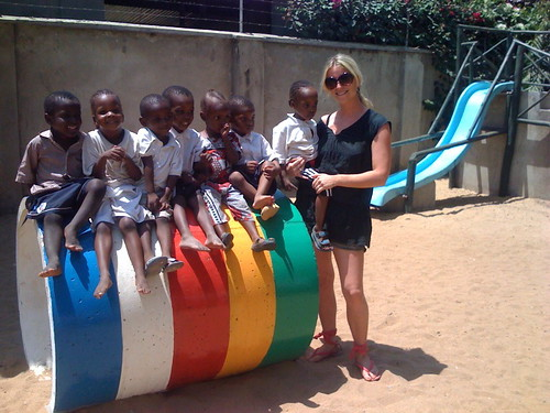 Children in  Joe Geeling Play park with Monica a volunteer.jpg