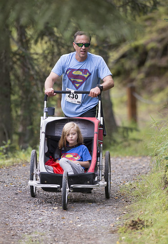 Peter Cannava works his way up a hill with members of his family on Saturday morning.