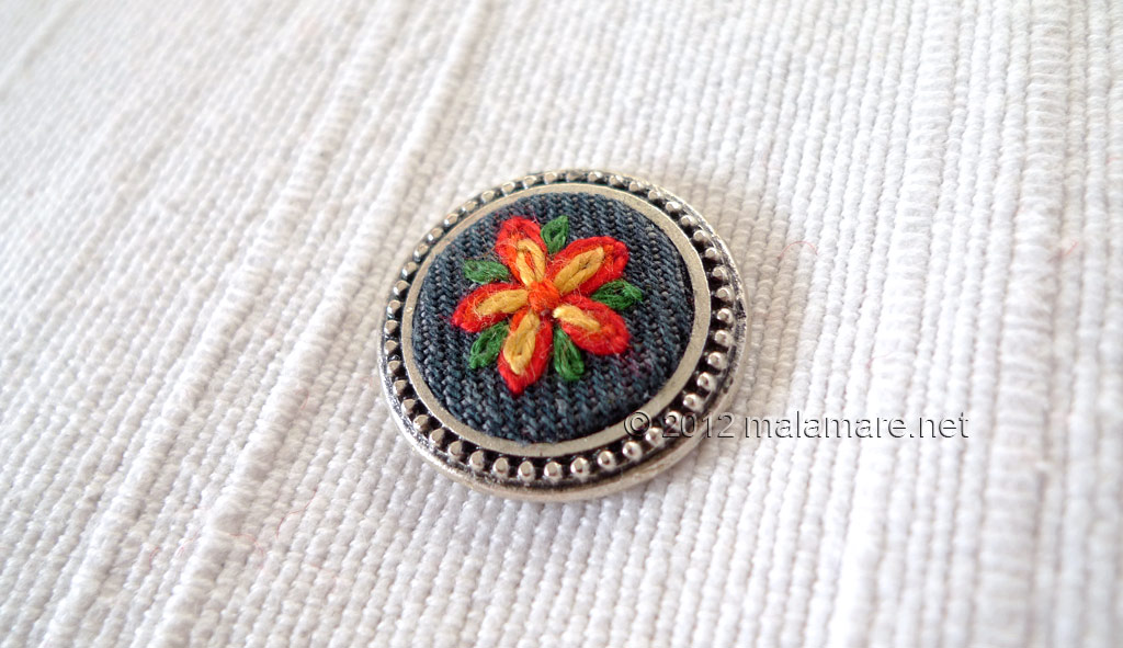 hand embroidery lazy daisy stitch red and yellow flower