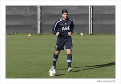goalkeeper(0.0), official(0.0), team(0.0), football player(1.0), ball(1.0), soccer kick(1.0), kick(1.0), sports(1.0), player(1.0), football(1.0), ball(1.0),